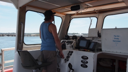 Mitch driving the boat! While Captain Chad got the poles ready.